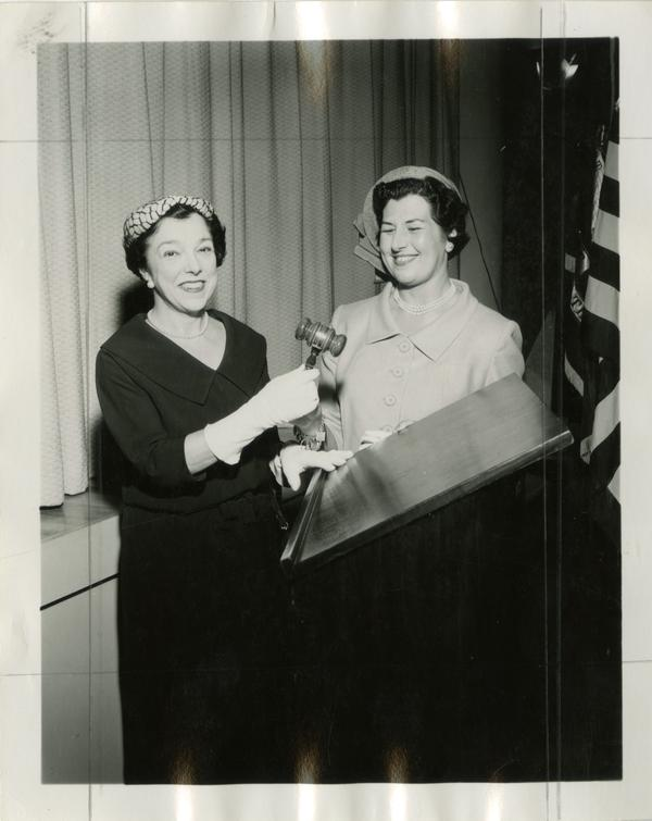 Ann Sumner and Carmella Speroni pose with gavel in the UCLA Faculty Women's Club on May 20, 1958