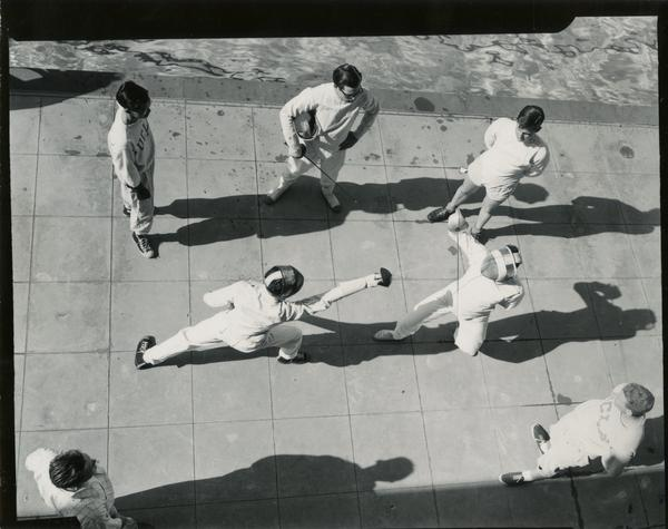 View from above of students engaging in fencing practice