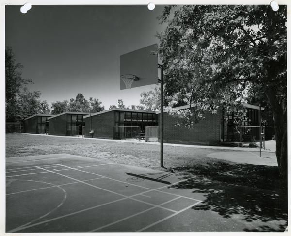 External view of classroom buildings from basketball courts
