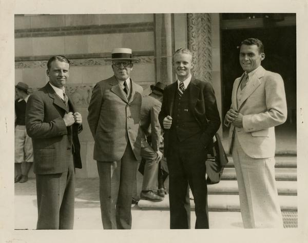 Kenny Piper, Dr. Ernest Carroll Moore, Bob Keith and Lowell Stanley stand in front of Powell Library on Opening Day, 1929