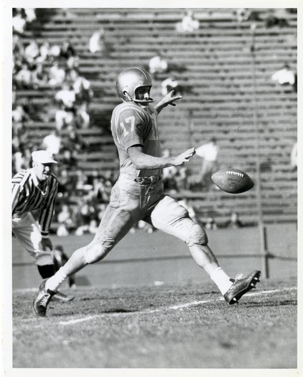 UCLA football player catching ball during practice