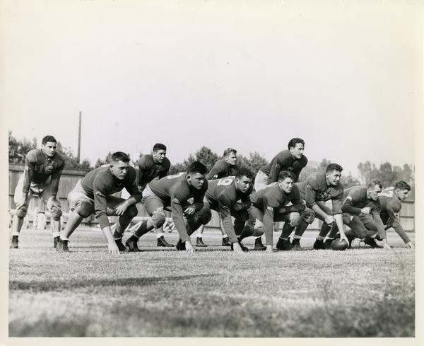 UCLA football players lined up during practice with Bob Waterfield as quarterback, 1944