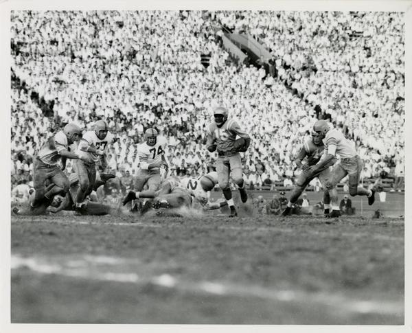 Football game action, ca. 1950s