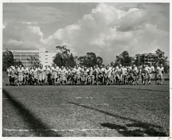 UCLA football team lined up and running, 1963