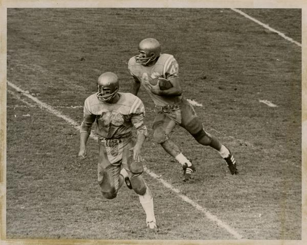 UCLA football player, possibly Steve Durbin, on the field during a game, ca. 1960s