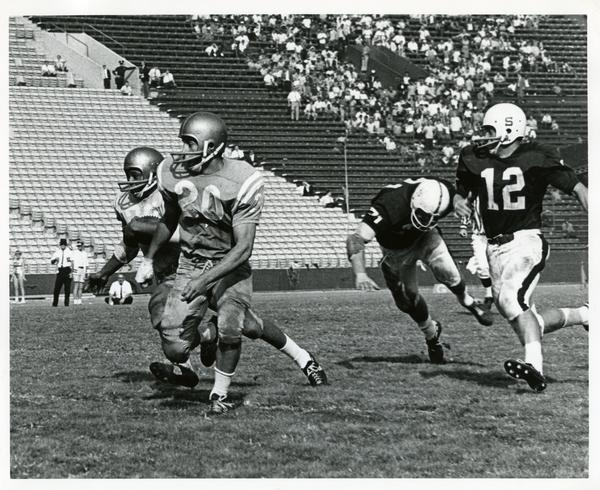 Football game action during UCLA v. Stanford game, ca. 1960s