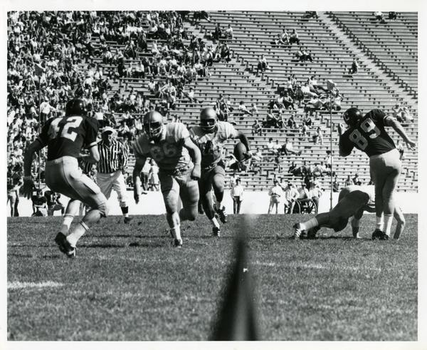 Football game action during UCLA v. Cal game, ca. 1960s