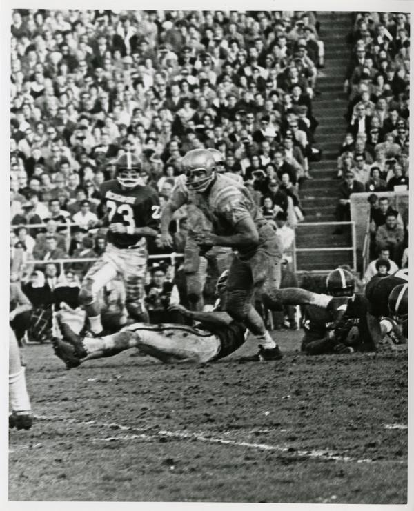 Football game action during UCLA v. Michigan State game at the Rose Bowl, January 1966