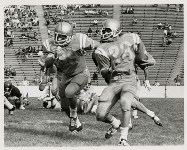 Football game action, ca. 1960s
