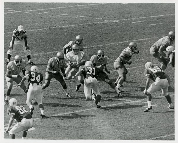 Football game action during UCLA v. Texas game, ca. 1970