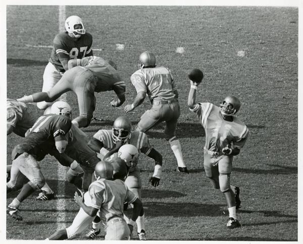 UCLA Quarterback Mike Flores (11), who completed 15 passes out of 36 attempts, fires one against the Texas Longhorns during game in the Coliseum, September 1971