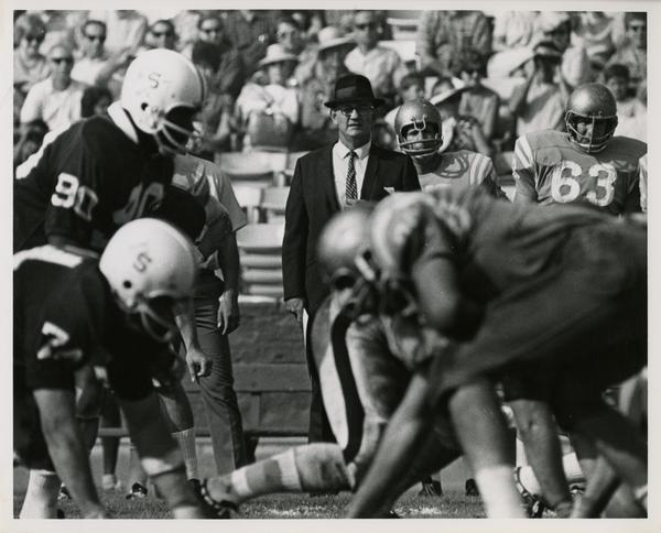 UCLA football coach Tommy Prothro watching a play in a game