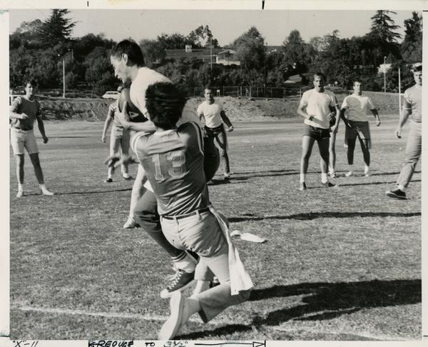UCLA intramural football players in practice