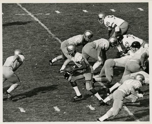 UCLA reserve quarterback Bill Bolden preparing for a handoff during a game against Oregon State