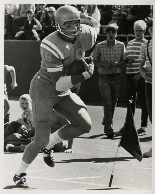 UCLA tight end Bob Christianson crossing the goal line in the football game against Oregon State University