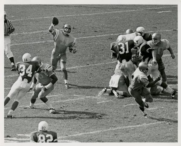 UCLA quarterback Mike Flores throwing the ball in a game, September 18, 1971