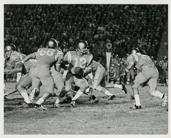 UCLA quarterback Scott Henderson passing during a game