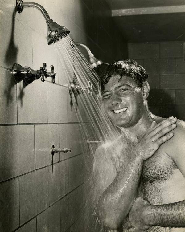 UCLA football player James Millette showering, 1947