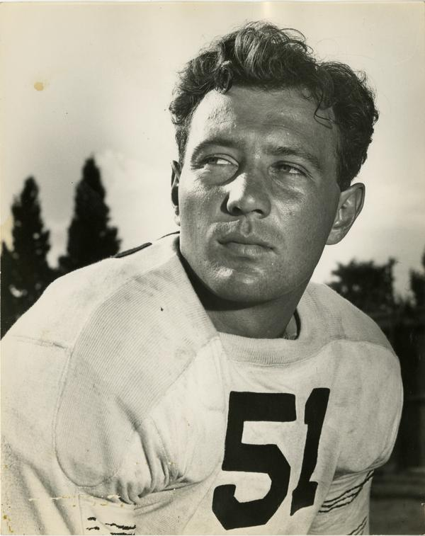 UCLA football player James Millette on the field, 1947