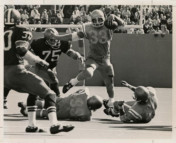 UCLA running back Randy Tyler running a play during a game