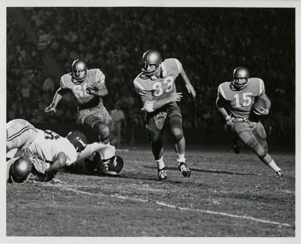 Quarterback Jim Nader running a sweep downfield during a football game