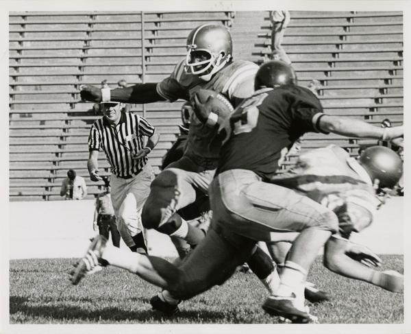 UCLA football player Larry Zeno running with the ball during a game