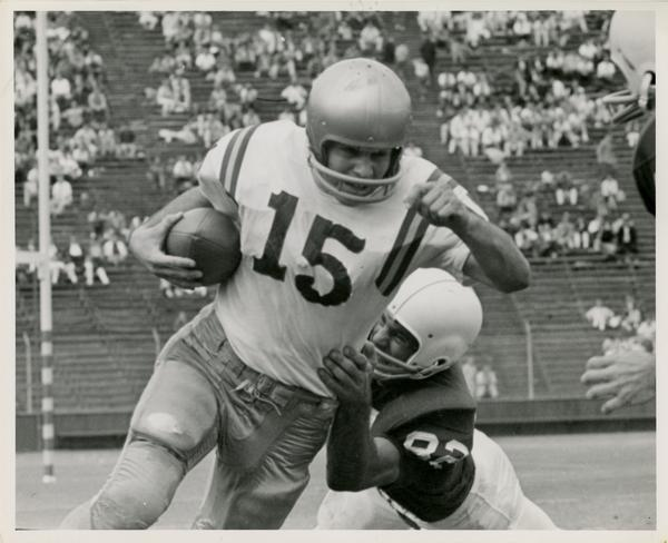 UCLA quarterback Larry Zeno running with the ball during a game