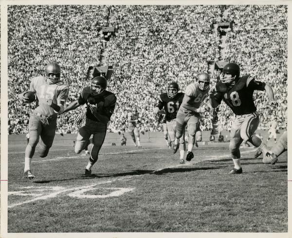 UCLA quarterback Larry Zeno running for open ground during a football game