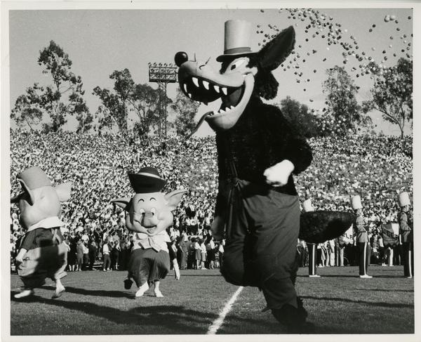 Mascots dancing at the Rose Bowl during a UCLA football game