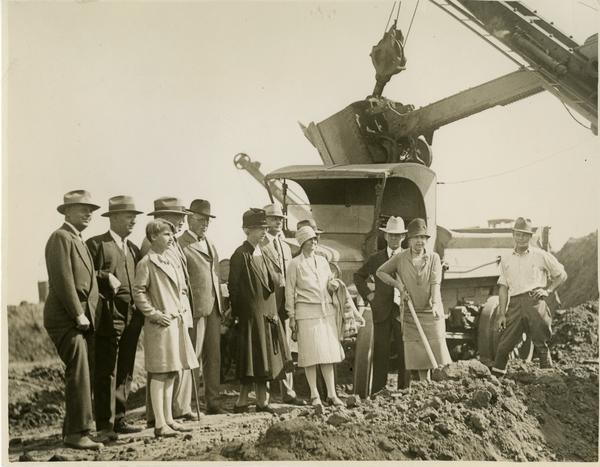 Woman with shovel breaks ground at new campus groundbreaking ceremony, October 1926