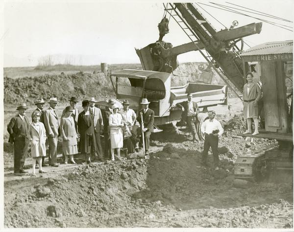 Man posing with shovel at new campus groundbreaking ceremony, October 1926