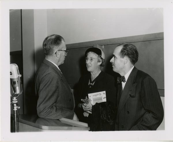 Lawrence Clark Powell with unidentified man and woman at Friends of the UCLA Library event