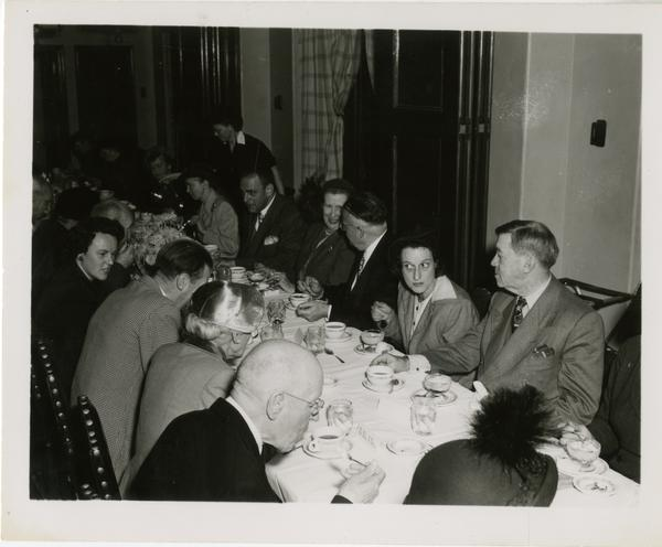 View of attendees seated around table at Friends of the UCLA Library banquet, November 1951