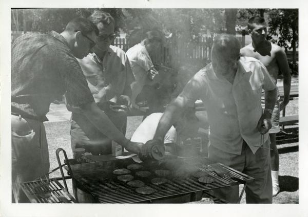 Richard Logan, Herb Eder, Peter Fielding, and Bob Lee grilling at a geography department picnic