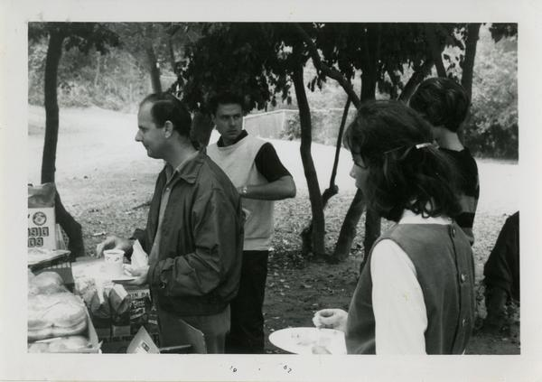 People waiting to eat food at the geography department picnic
