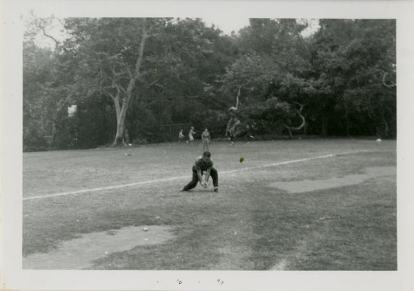 Student catching a ballat a geography department picnic