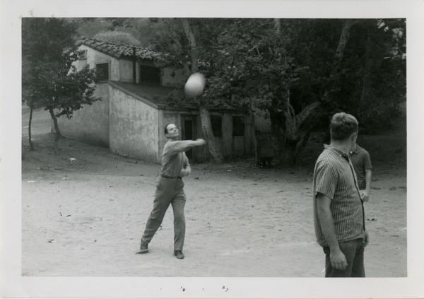 Man hitting a volleyball at the geography department picnic