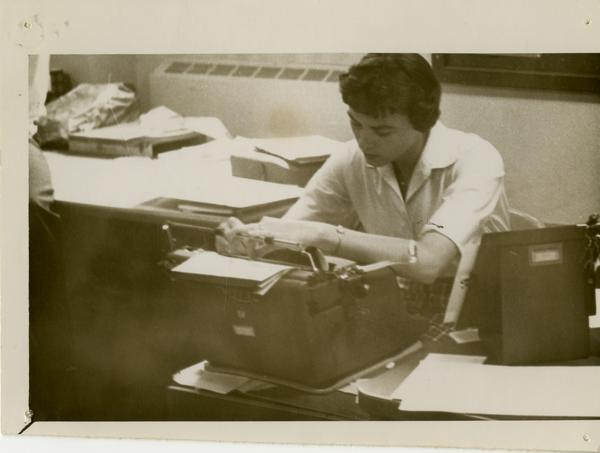 Geography department faculty member working at a typewriter