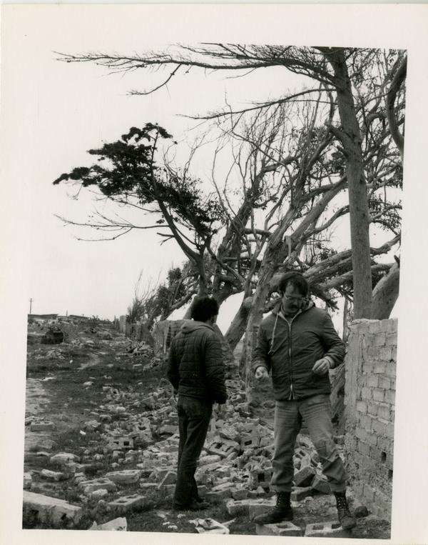 Two unidentified faculty members of the geography department examine the outdoor scenery