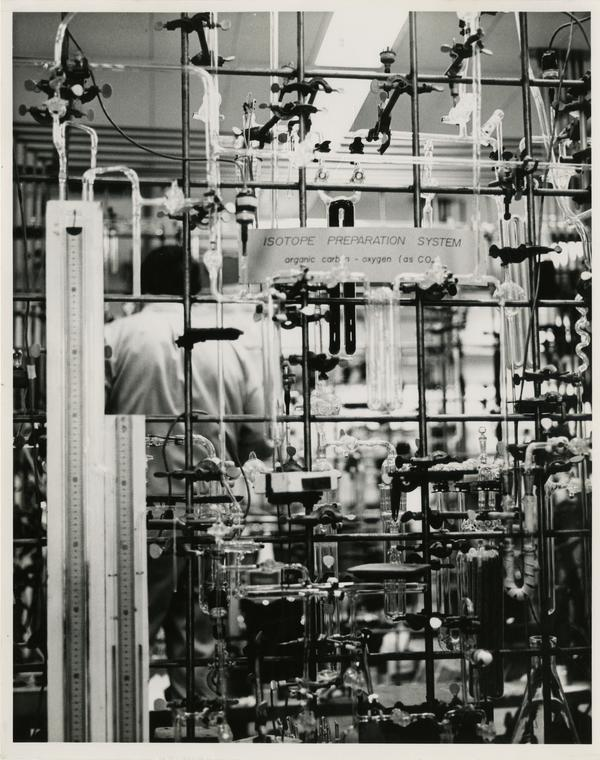 Isotope Preparation System in the Geophysics Department laboratory with a worker in the background