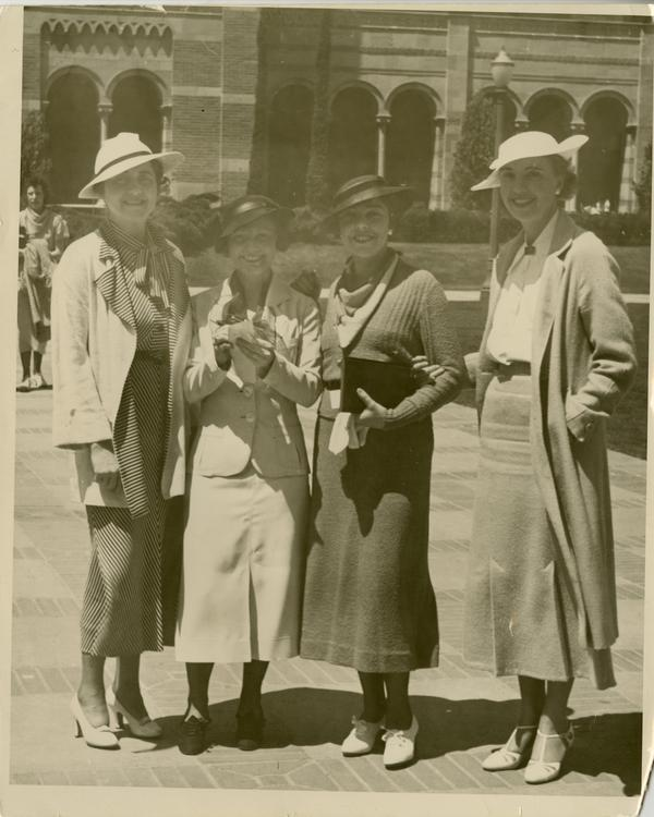 Elizabeth Lloynd Denis, Hansena Frederickson, Ann Sumner, and Albertina Rodi pose for a photo with Royce Hall in the background at the Gold Shield Alumnae of UCLA event, ca. 1937
