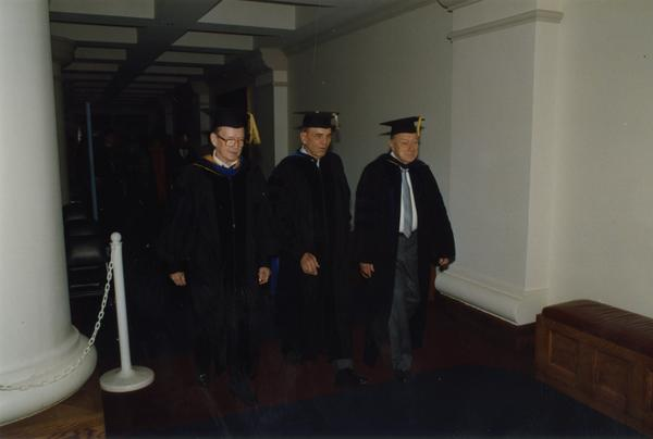 Faculty lining up for the PhD Hooding Ceremony