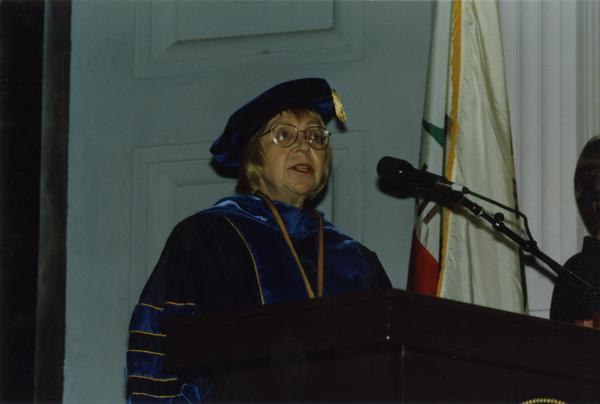 Victoria Fromkin at podium during PhD Hooding Ceremony, June 1988