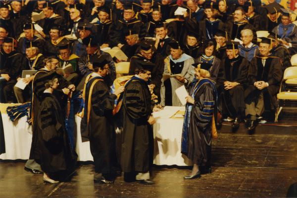 Faculty hooding a PhD candidate, June 1988