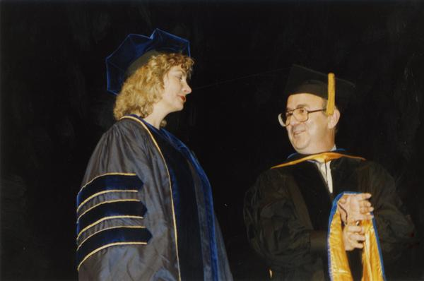 Graduate stands with David Kaplan during PhD Hooding Ceremony, June 1988