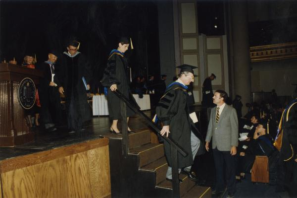 Faculty walk down from the stage during PhD Hooding Ceremony, June 1988