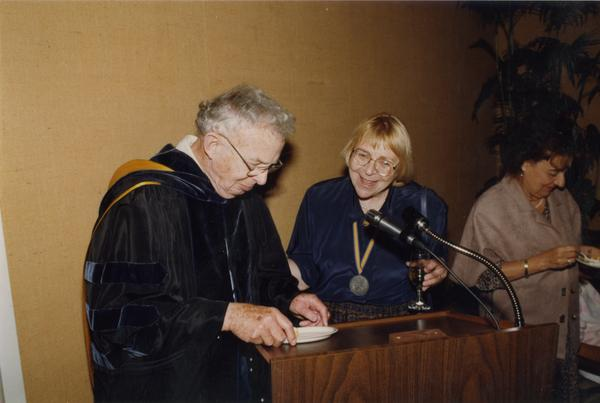 Raymond Fisher and Victoria Fromkin at podium during Robing Reception, June 1988