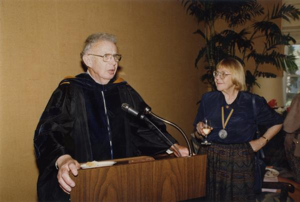 Raymond Fisher speaks at podium with Victoria Fromkin at his side during Robing Reception, June 1988