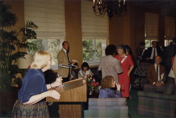 Victoria Fromkin speaks at podium, June 1988
