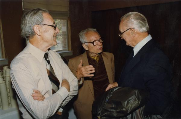 Joseph Gengerelli and Donald Lindsley speak with unidentified man at gathering for PhD Hooding Ceremony, June 1988